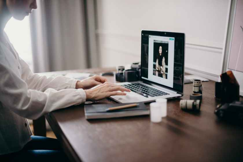 selective focus photography of woman using macbook pro